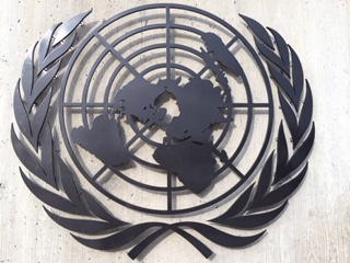 Black Metal Image appears on concrete wall at UN in Geneva